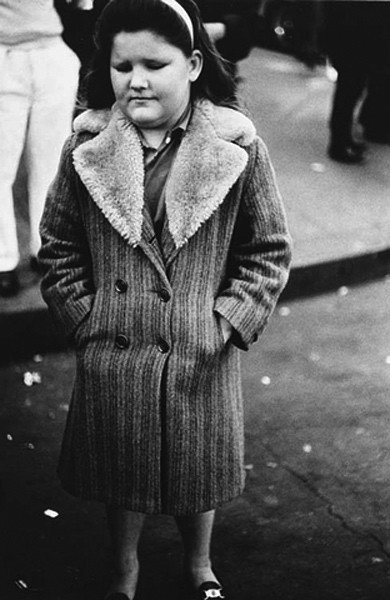 8A: Diane Arbus, Girl in a Storm Overcoat, NYC, 1960/