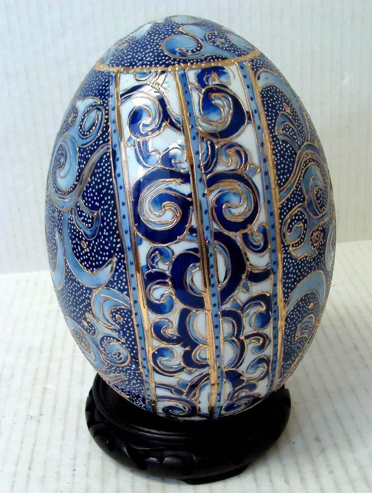 """1078: 8"""" Tall Blue Porcelain Enameled Egg On base"""