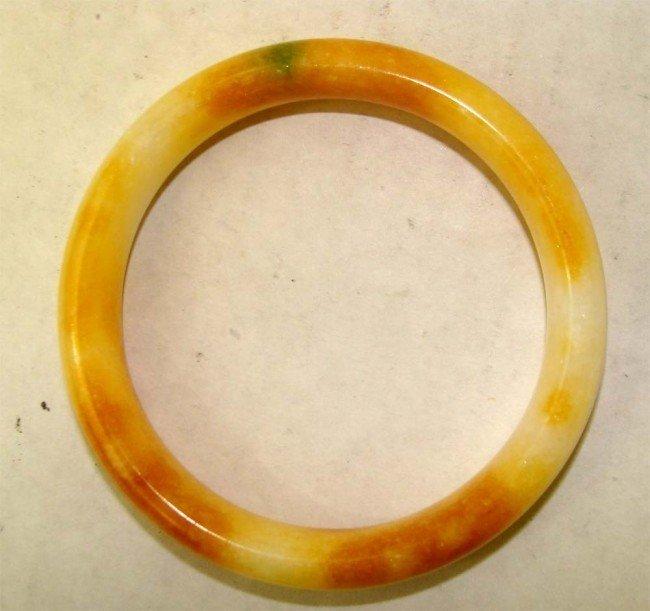 1071: One Chinese Orange & White Stone Bangle Bracelet