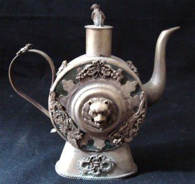 Chinese Etched Metal Lion Teapot With Monkey Lid