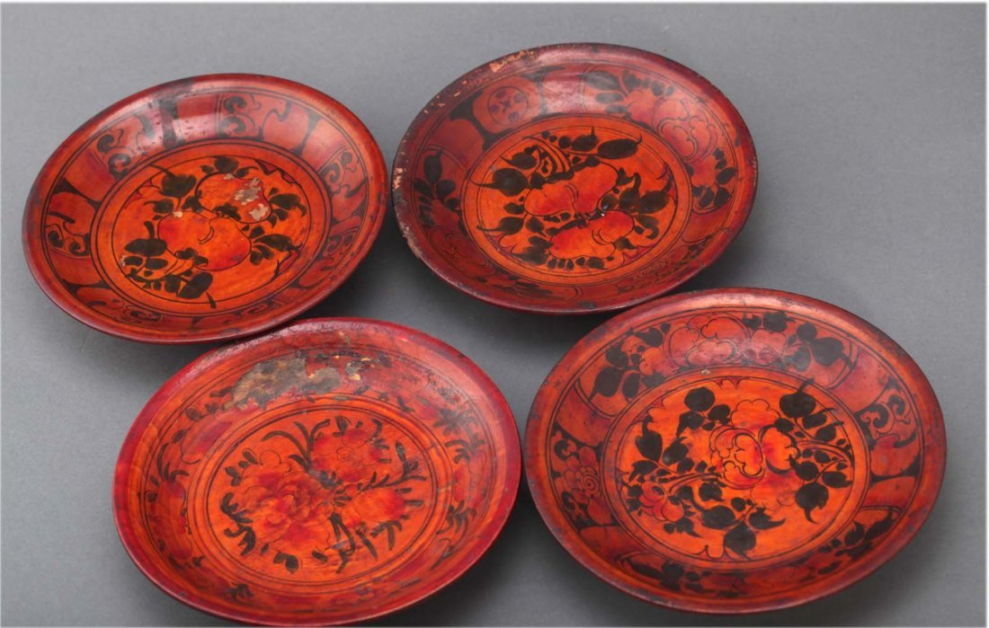 Set of four Chinese lacquer dishes. Depicting flowers.