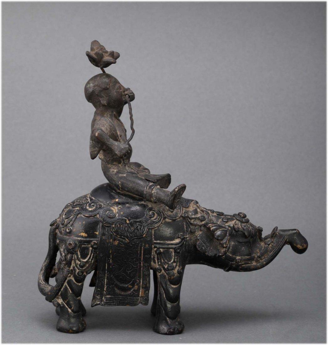 Chinese antique Bronze figure group on Elephant