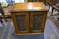 8: Oak Smokers Cabinet with Carved Front Doors Size: Ap
