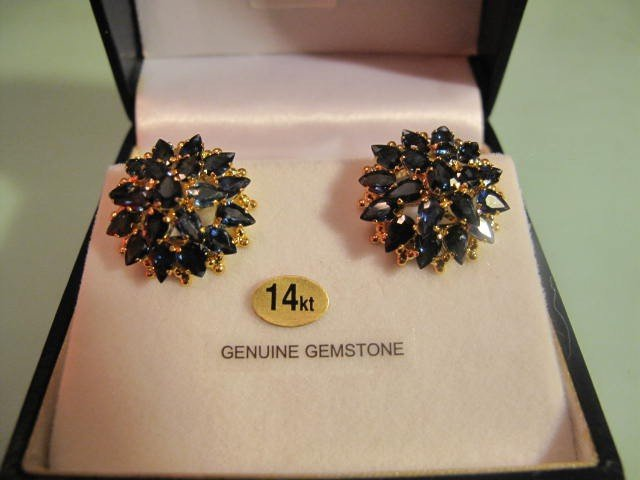 36: 14kt. Gold earrings with 38 pear Blue sapphires $4,