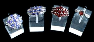 Group, Four Sterling Silver & Gemstone Rings