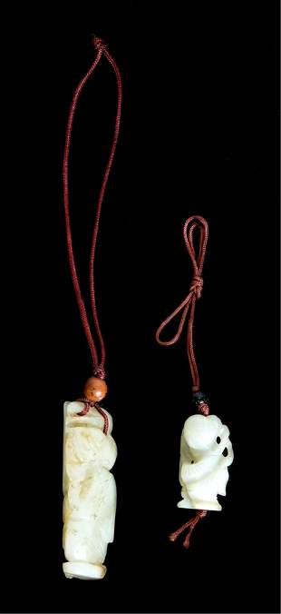 Two Chinese Celadon Jade Carved Pendants