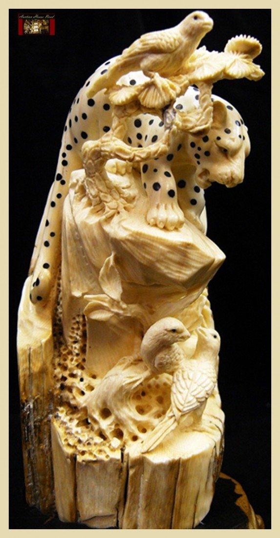 22: Ivory Leopard & Bird