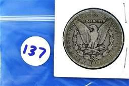 137: One (1) 1879 CC Morgan Silver Dollar