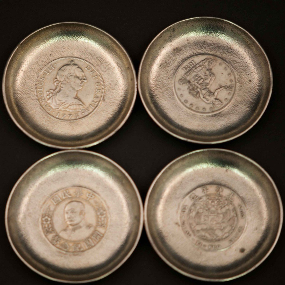 12: A Set of 4 Chinese Silver Coaster