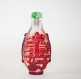 12: Chinese Pekin Glass Snuff Bottle with Red Overlay