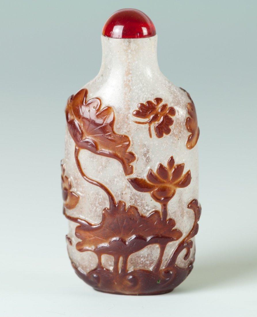 Chinese Brown Overlay Pekin Glass Snuff Bottle in Lotus