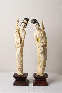 1042: PAIR OF CHINESE CARED IVORY FIGURES ON STAND