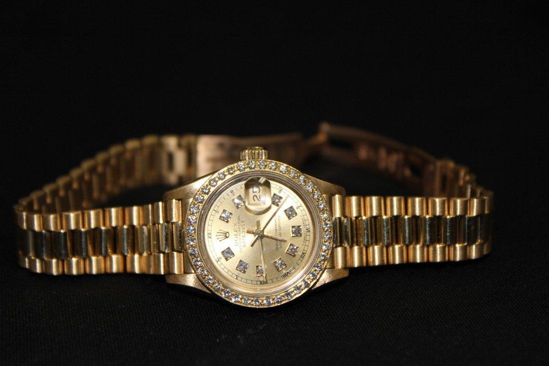 5013: Rolex 18 kT gold  diamond date just ladies wrist