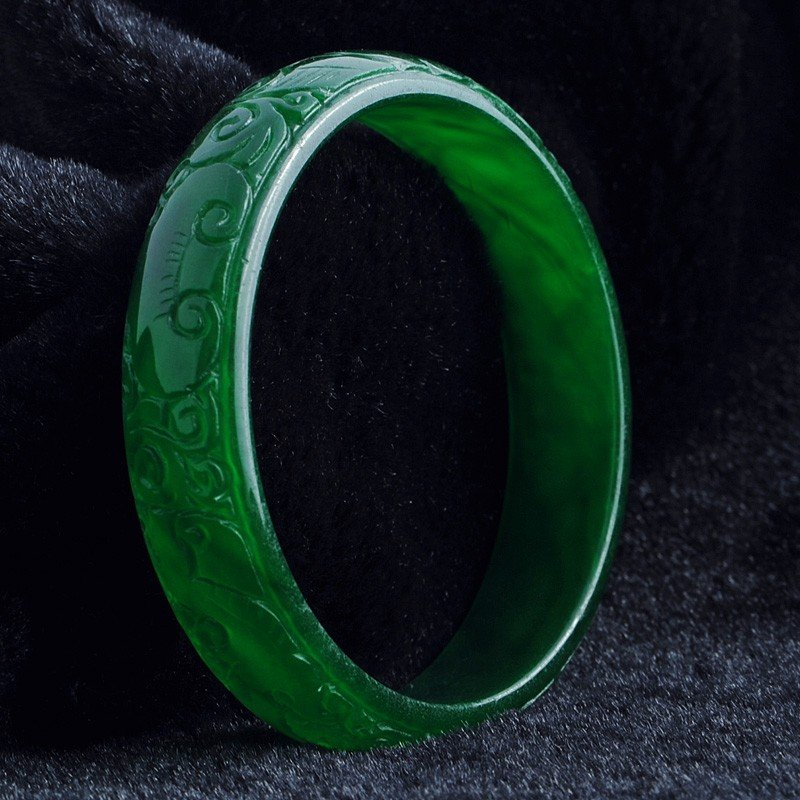 5050: CHINESE CARVED JADEITE BRACELET