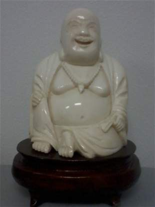 CHINESE CARVED IVORY BUDDHA WITH A STAND