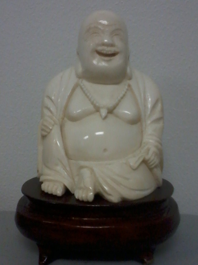 4003: CHINESE CARVED IVORY BUDDHA WITH A STAND