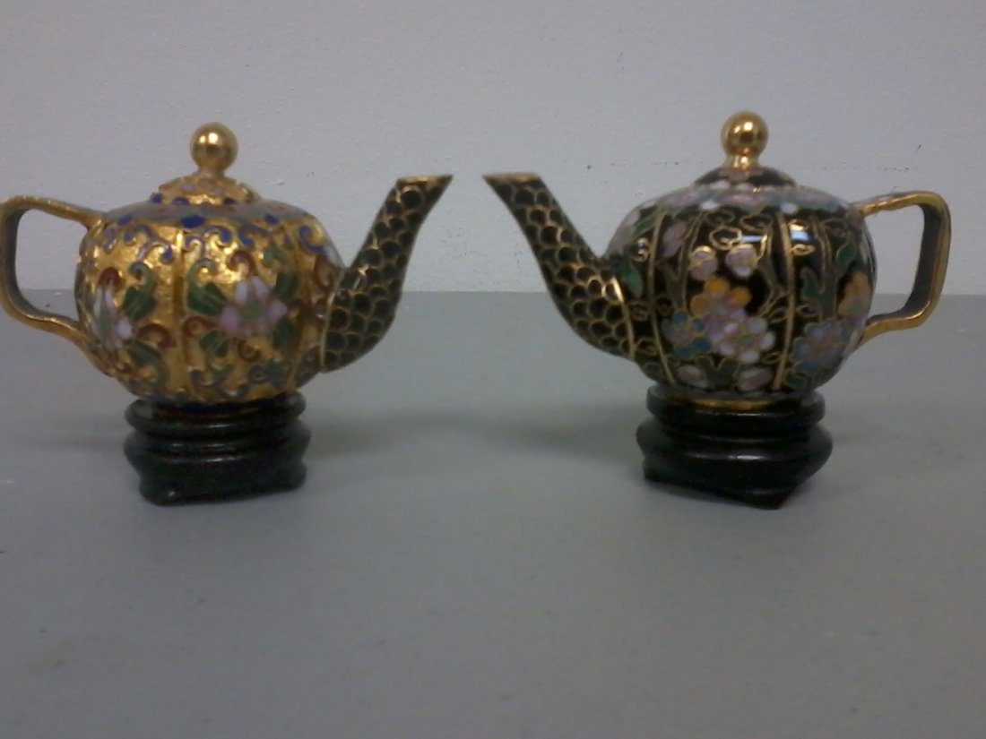 6003: Pair of Chinese cloisonne teapots on the wooden s