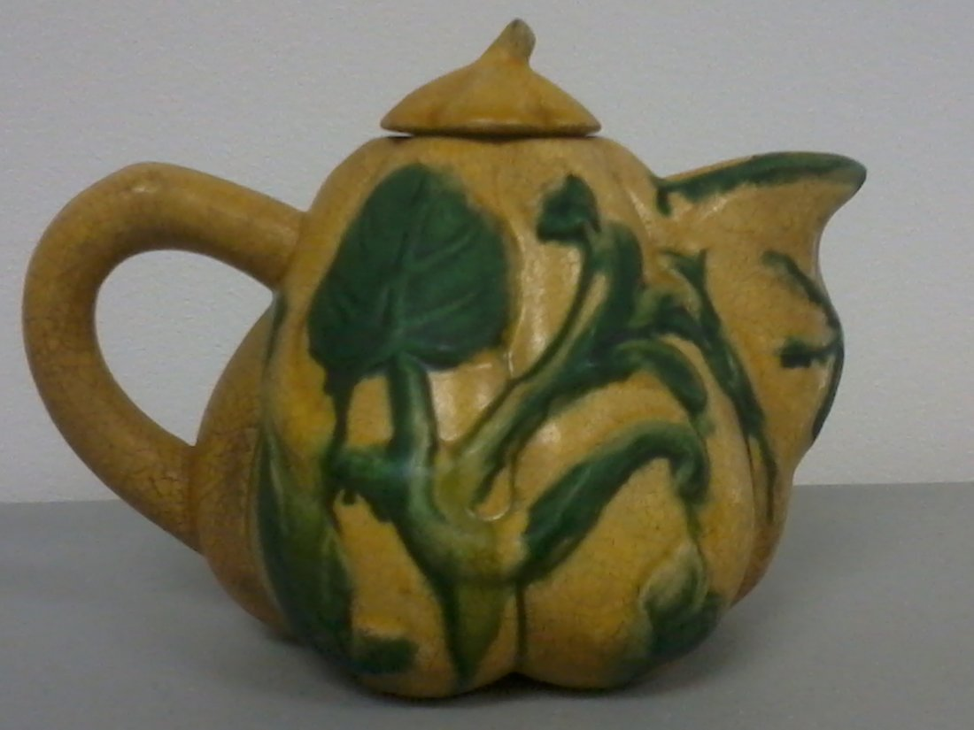7002: Very nicely carved Chinese pottery teapot
