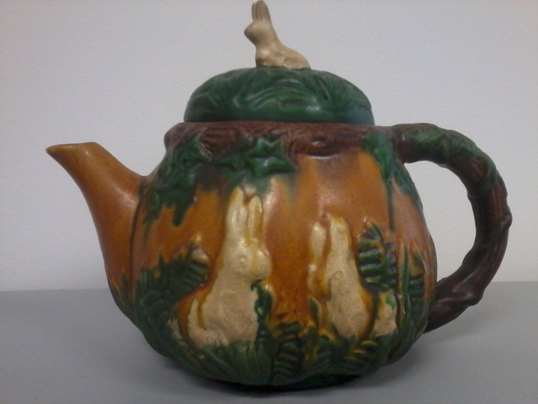7003: Very nicely carved Chinese pottery teapot