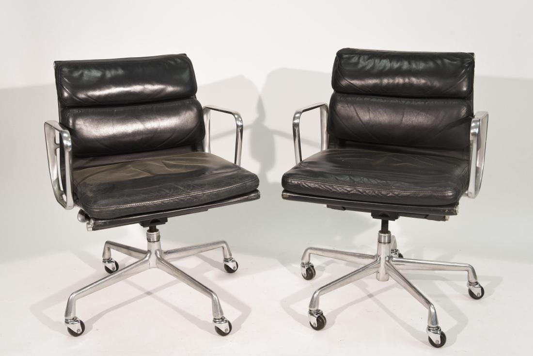PAIR OF EAMES SOFT PAD LEATHER CHAIRS