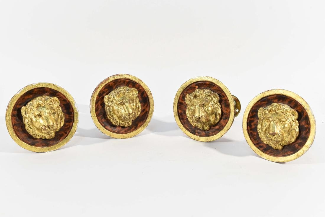 (4) BRASS AND WOOD TIE BACKS WITH LION HEADS