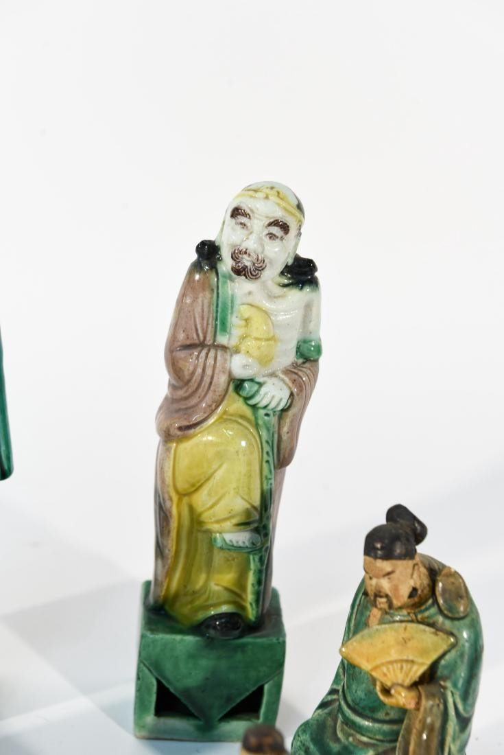 GROUPING OF CHINESE MUD MEN & FIGURAL COASTERS - 8