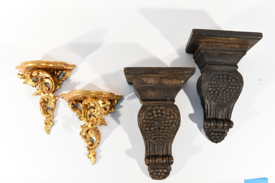 TWO PAIRS OF CARVED WOOD WALL SHELVES
