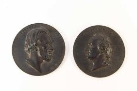 PAIR OF BOIS DURCI PRESIDENTIAL PLAQUES