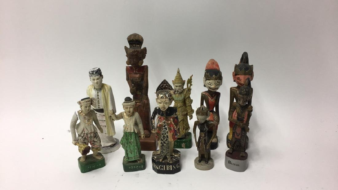 GROUPING OF INDONESIAN WOODEN CARVED FIGURES