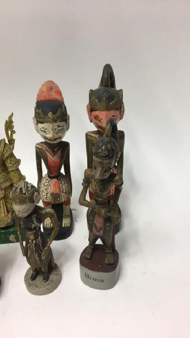 GROUPING OF INDONESIAN WOODEN CARVED FIGURES - 5