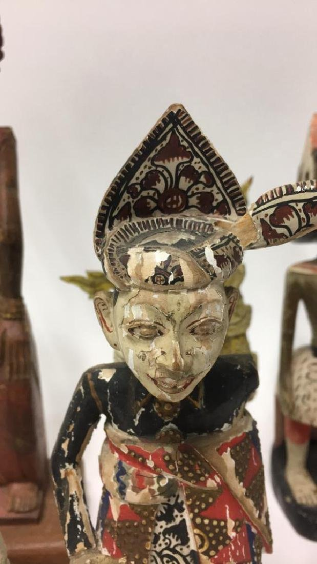 GROUPING OF INDONESIAN WOODEN CARVED FIGURES - 7