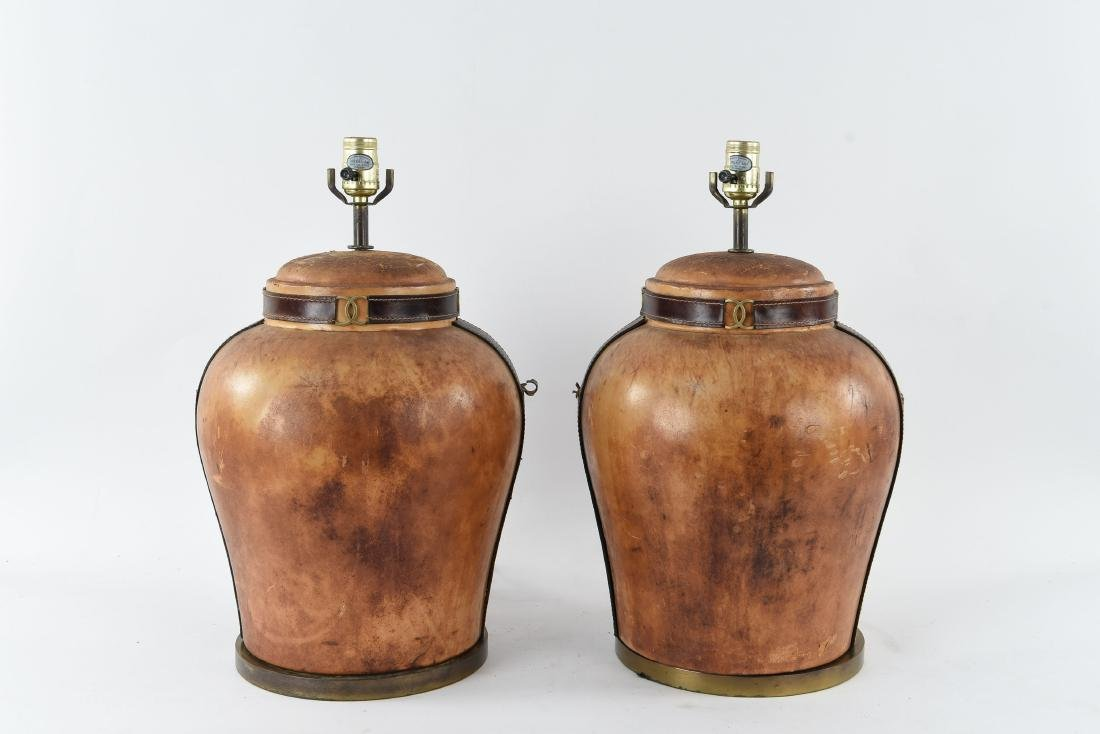 PAIR OF LEATHER CLAD LAMPS