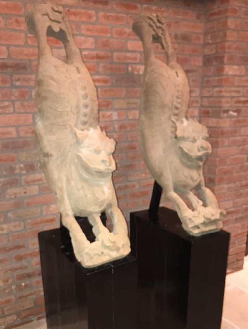 PAIR OF CHINESE CARVED WOOD FOO DOGS