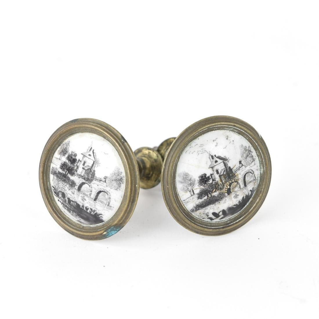 (2) PAINTED PORCELAIN AND BRASS TIE BACK KNOBS
