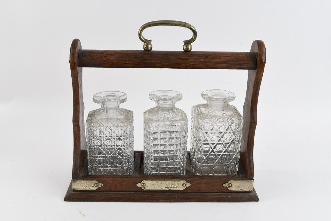 ANTIQUE ENGLISH TANTALUS LIQUOR DECANTERS