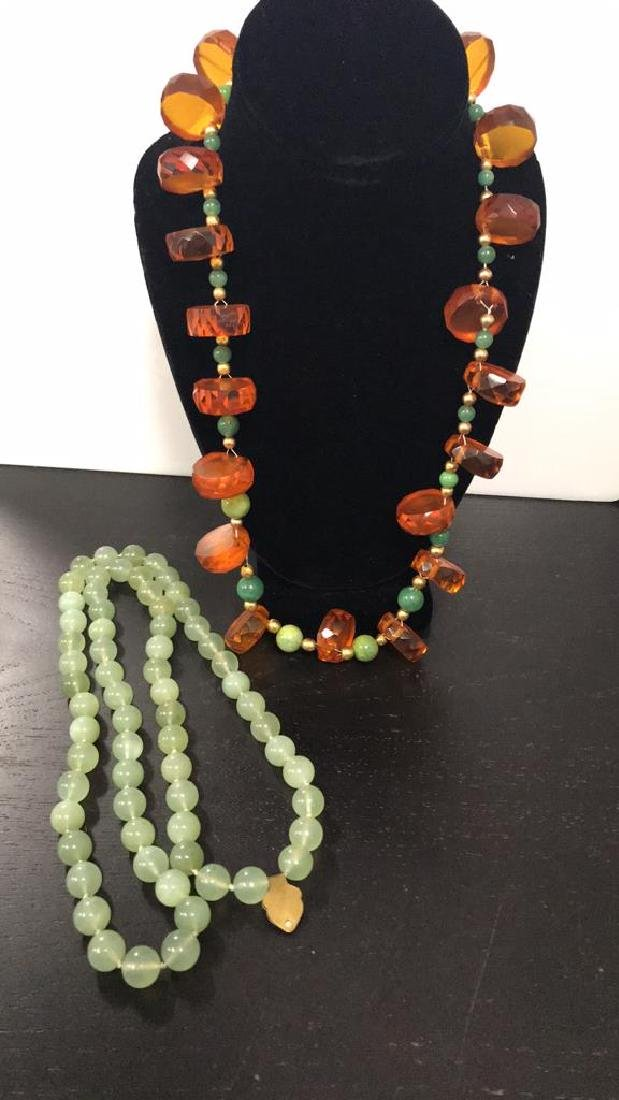 (2) NECKLACES INCLUDING JADEITE AND AMBER