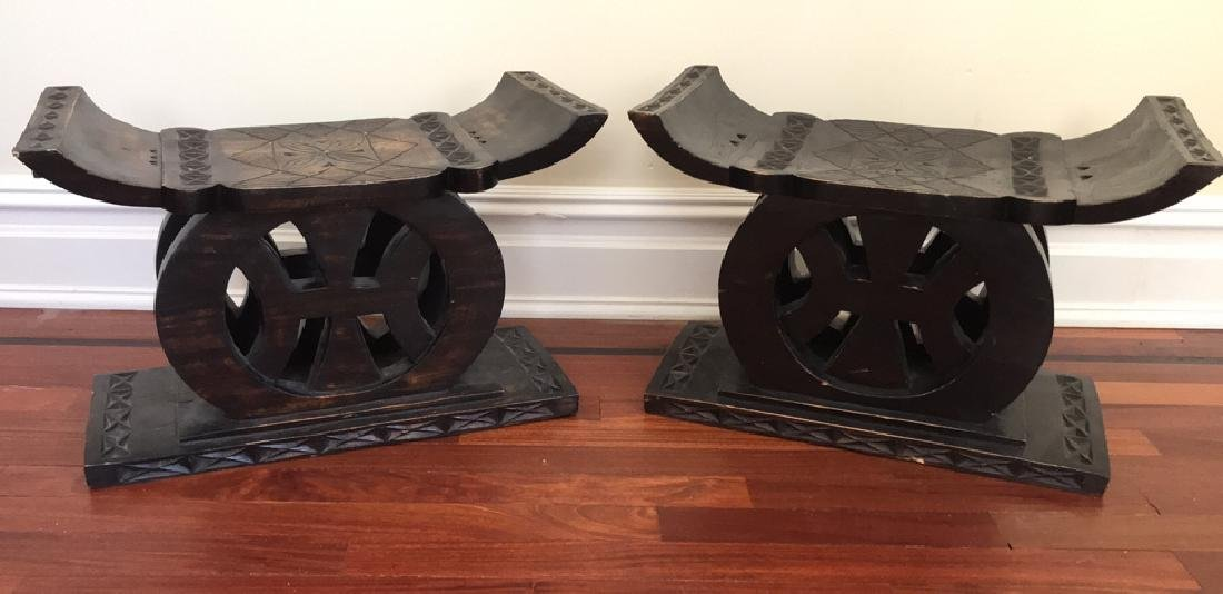 PAIR OF CARVED WOOD STOOLS