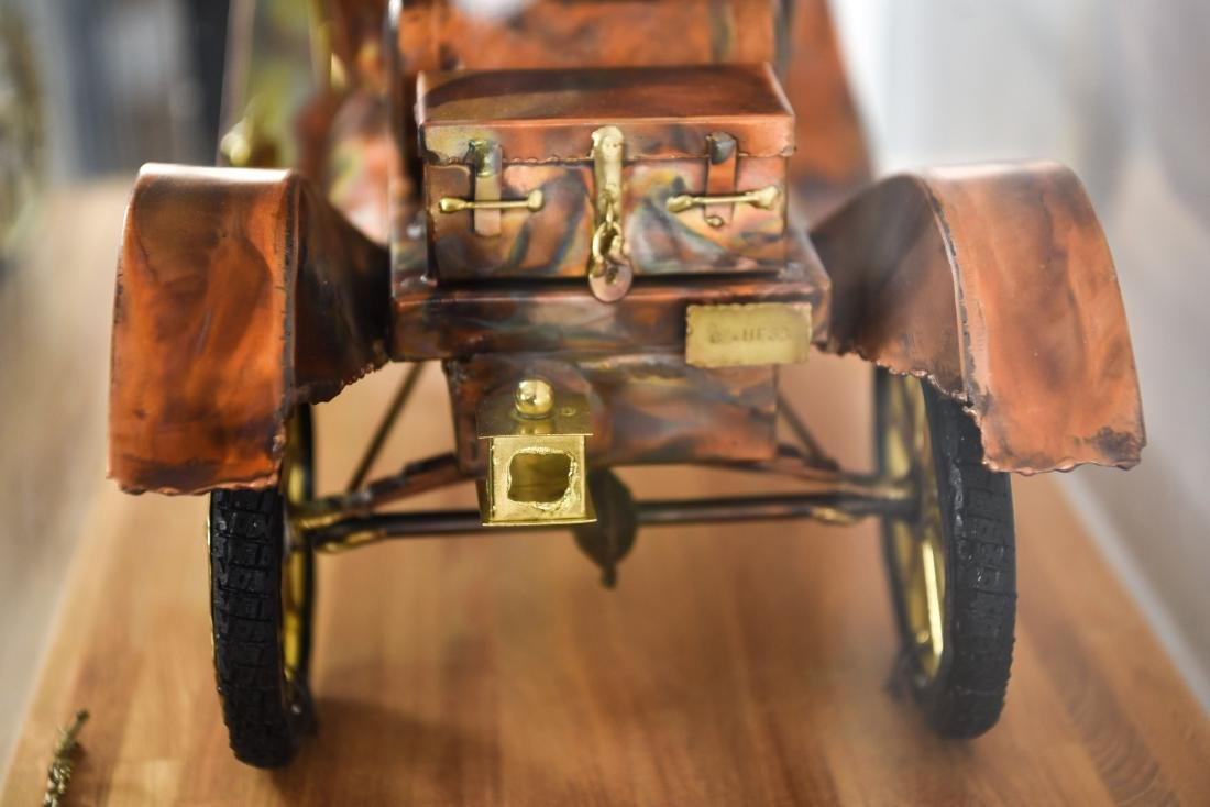 C. HESS MODEL T CAR SCULPTURE AND PEDESTAL - 10