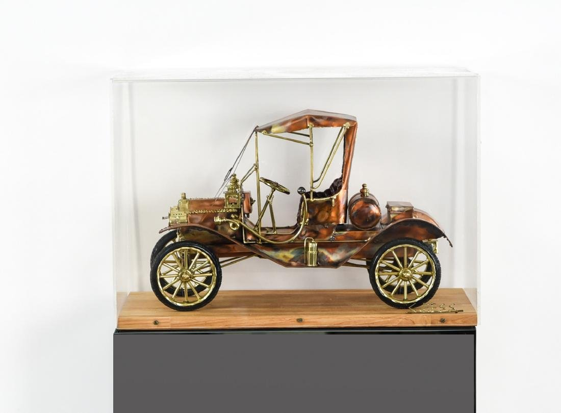 C. HESS MODEL T CAR SCULPTURE AND PEDESTAL