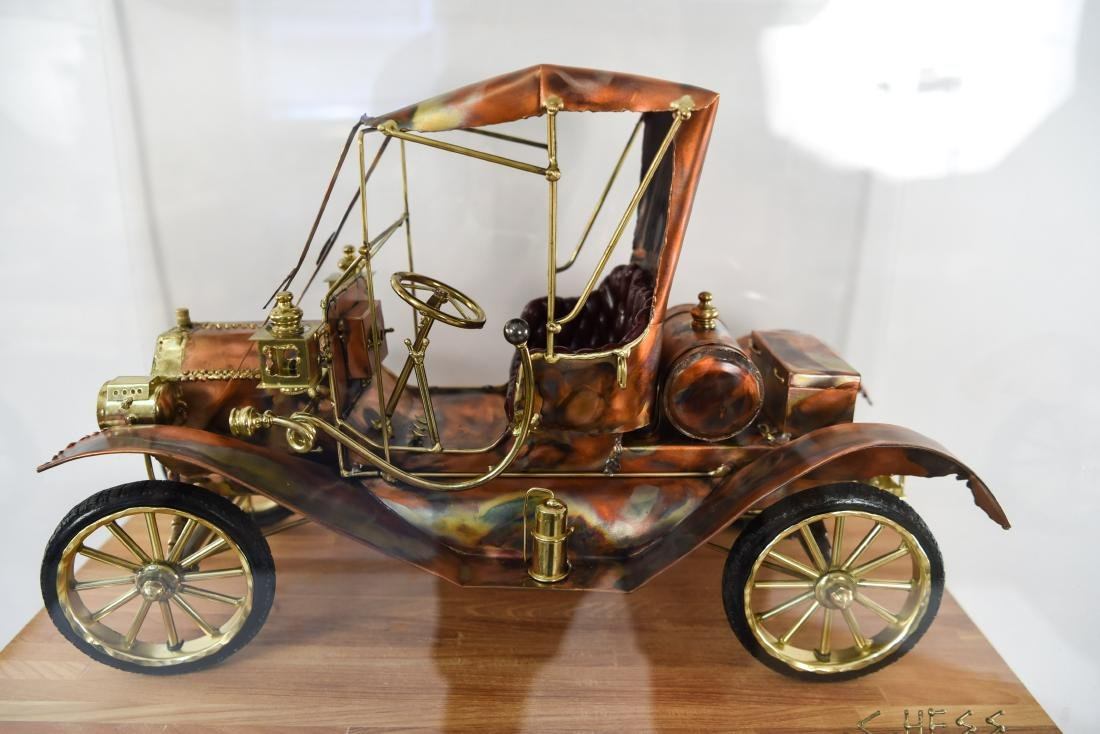 C. HESS MODEL T CAR SCULPTURE AND PEDESTAL - 2
