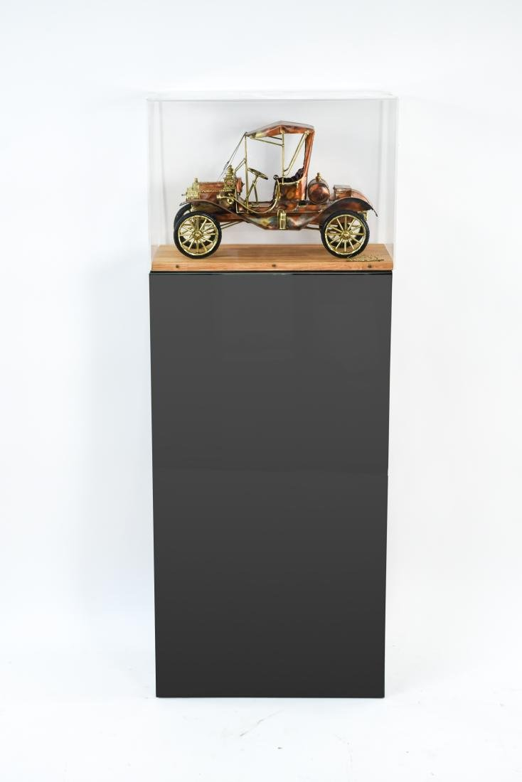 C. HESS MODEL T CAR SCULPTURE AND PEDESTAL - 3