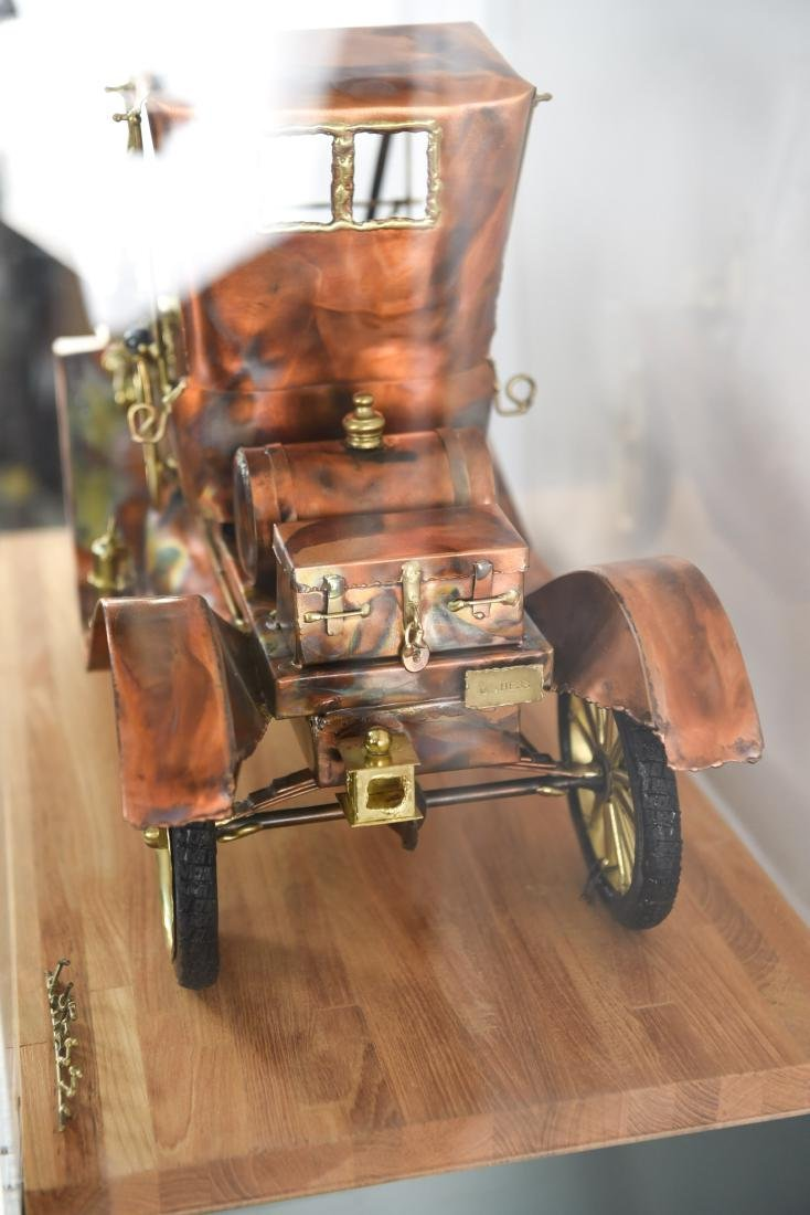 C. HESS MODEL T CAR SCULPTURE AND PEDESTAL - 9