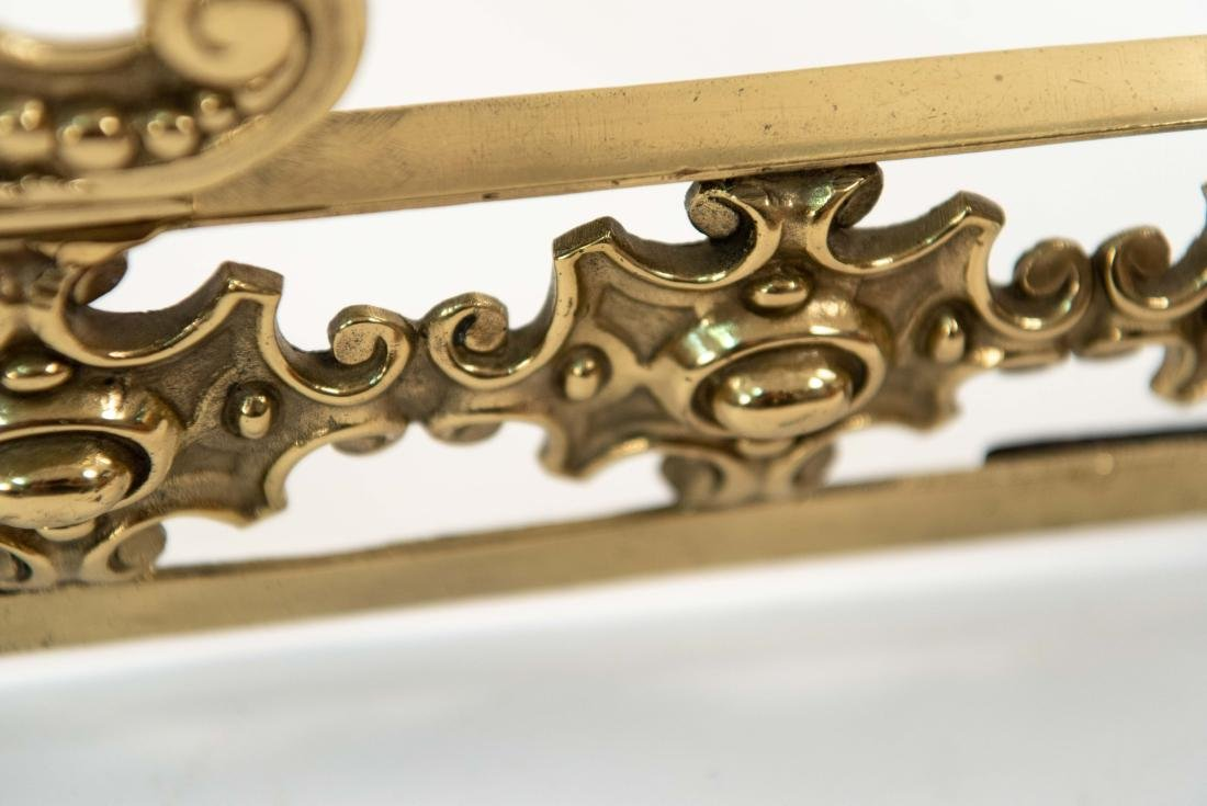 ORNATE BRASS FIRE FENDER W/ FACES - 10