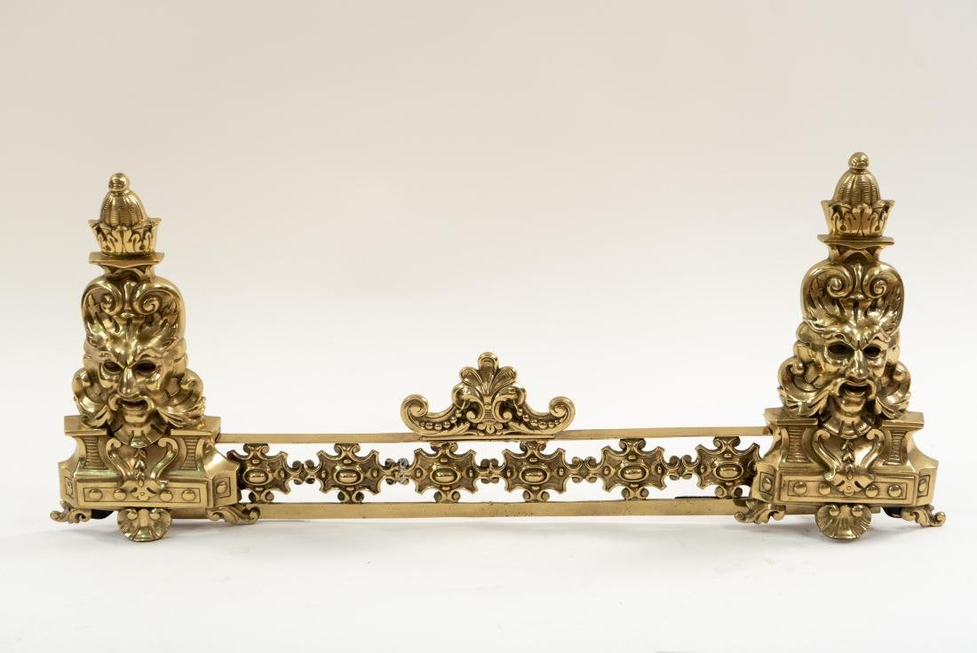ORNATE BRASS FIRE FENDER W/ FACES