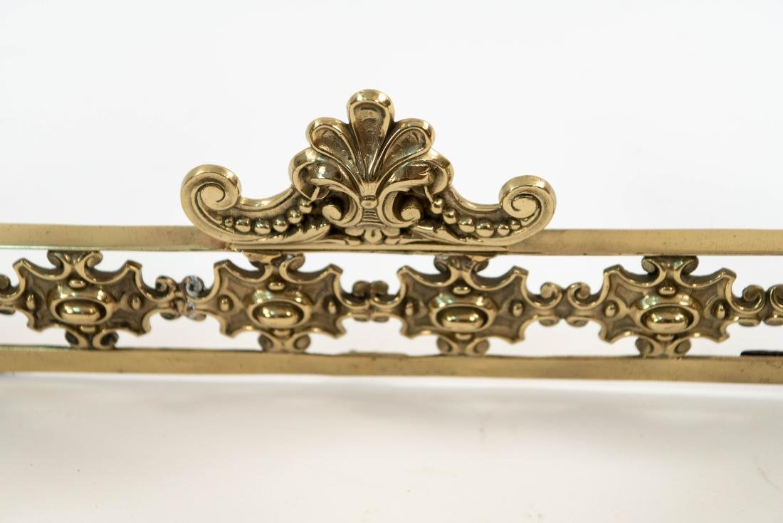 ORNATE BRASS FIRE FENDER W/ FACES - 4