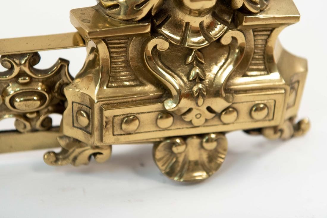 ORNATE BRASS FIRE FENDER W/ FACES - 5