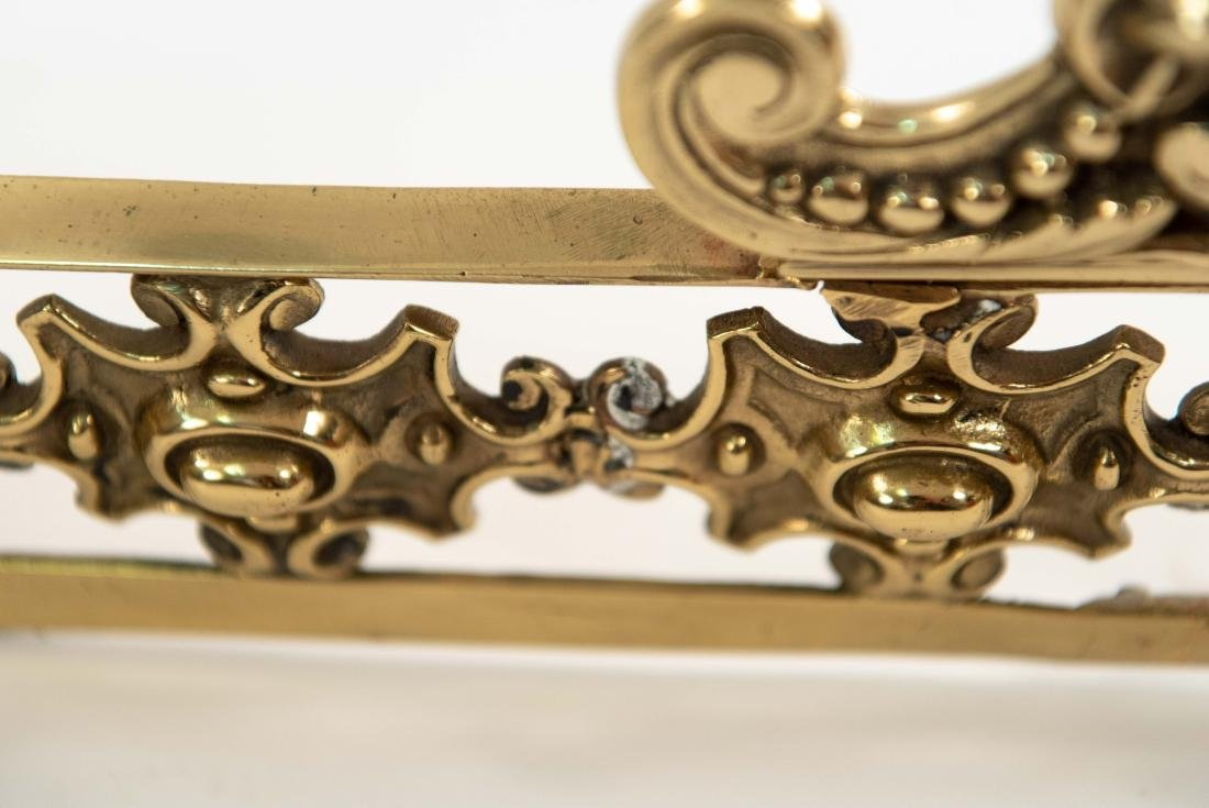 ORNATE BRASS FIRE FENDER W/ FACES - 8