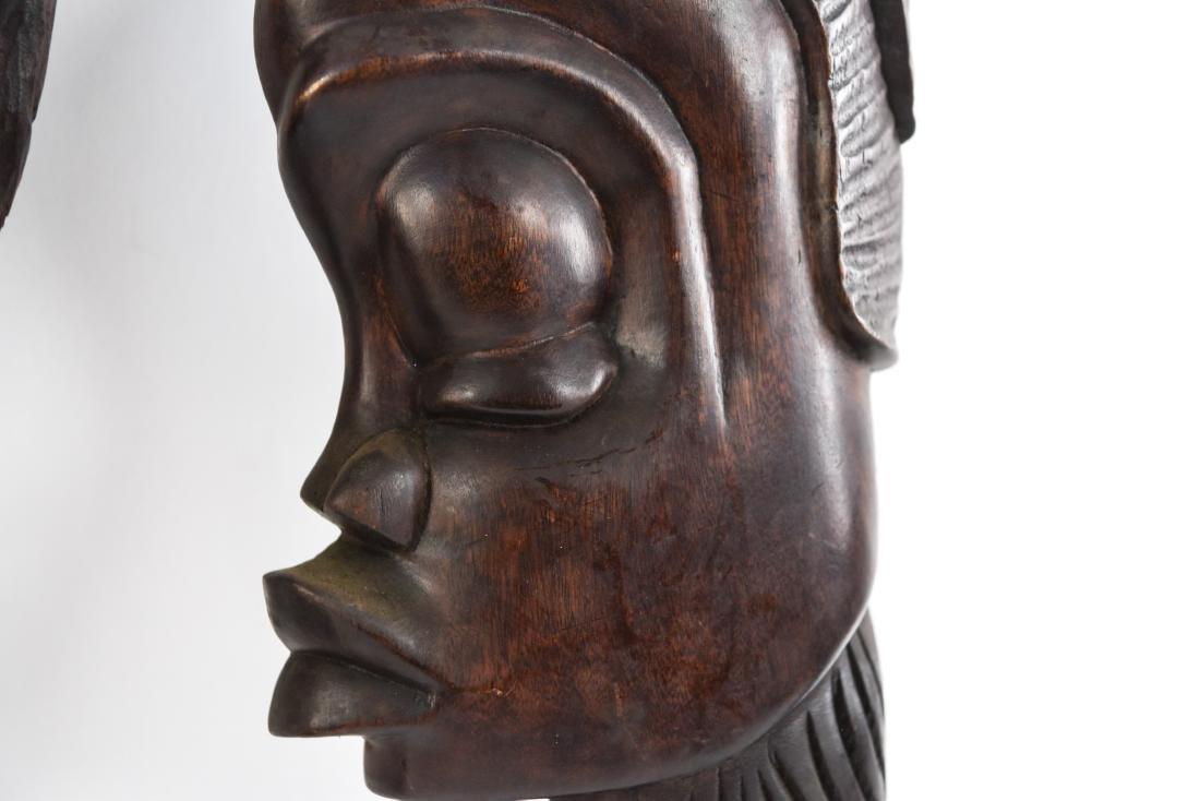GROUPING OF HAITIAN CARVED WOODEN MASKS - 11