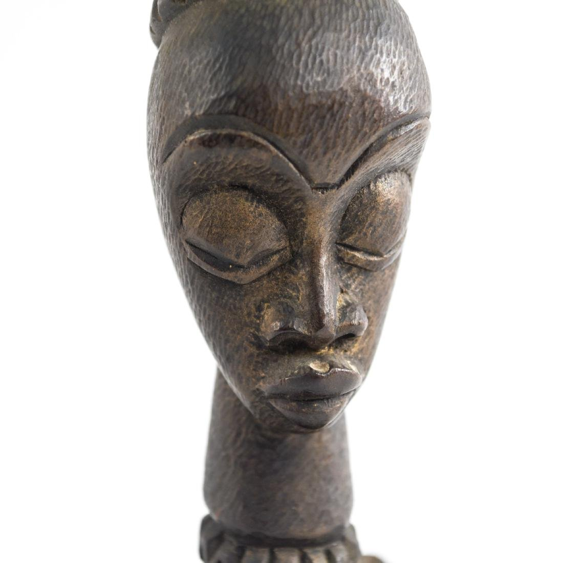 GROUPING OF HAITIAN CARVED WOODEN MASKS - 18