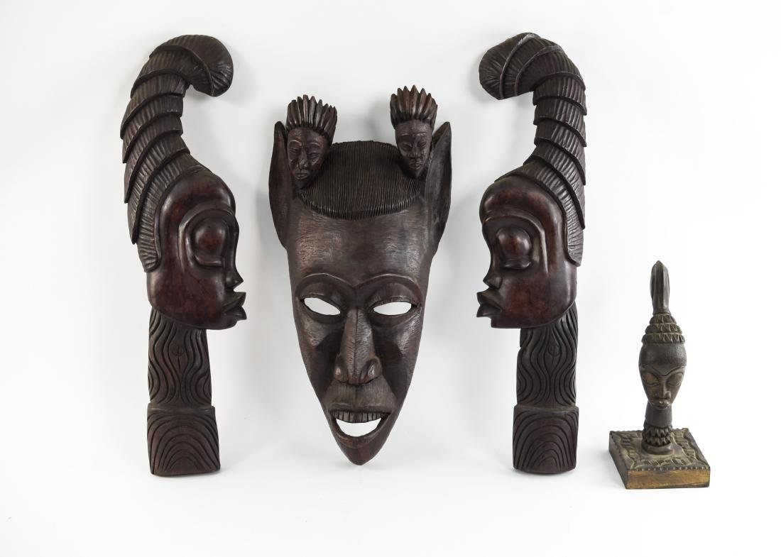GROUPING OF HAITIAN CARVED WOODEN MASKS